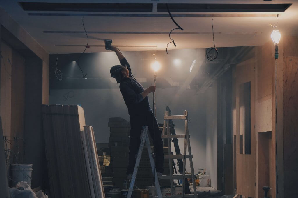 Hobart Buyers Agents - Custom Services Image For Relocation, Auction, Project Management - Construction Worker Fixing the Ceiling